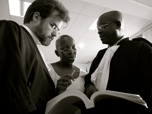 Victoire Ingabire consults her legal team, before trial is adjourned at Kigali Supreme Court. © Graham Holliday
