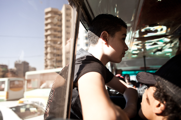 Ultra Moustafa, 16, in a bus that brings the Ultras to the Police Academy in Cairo. © Ben Kilb
