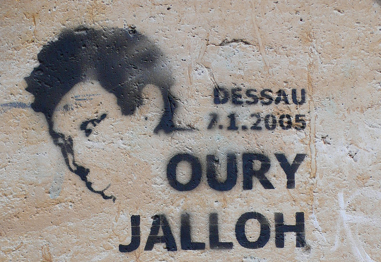 Why did Oury Jalloh burn to death on a fireproof mattress in a German police cell?