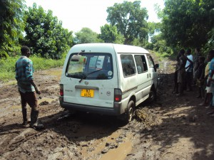 Pursuit of the floods victims plight wasn't without challenges, Eufrika crew vehicle got stuck in the mud (Photo by Deogracias Benjamin Kalima)