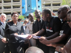 SA ambassador to Makawi receiving the petition (Photo by Tiyamike Mao Njanji)