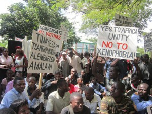 Some of the protestants carrying placards (Photo by Tiyamike Mao Njanji)